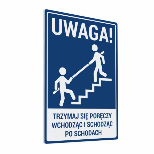 Naklejka ostrzegawcza Uwaga, Trzymaj się poręczy wchodząc i schodząc po schodach. Naklejka BHP.